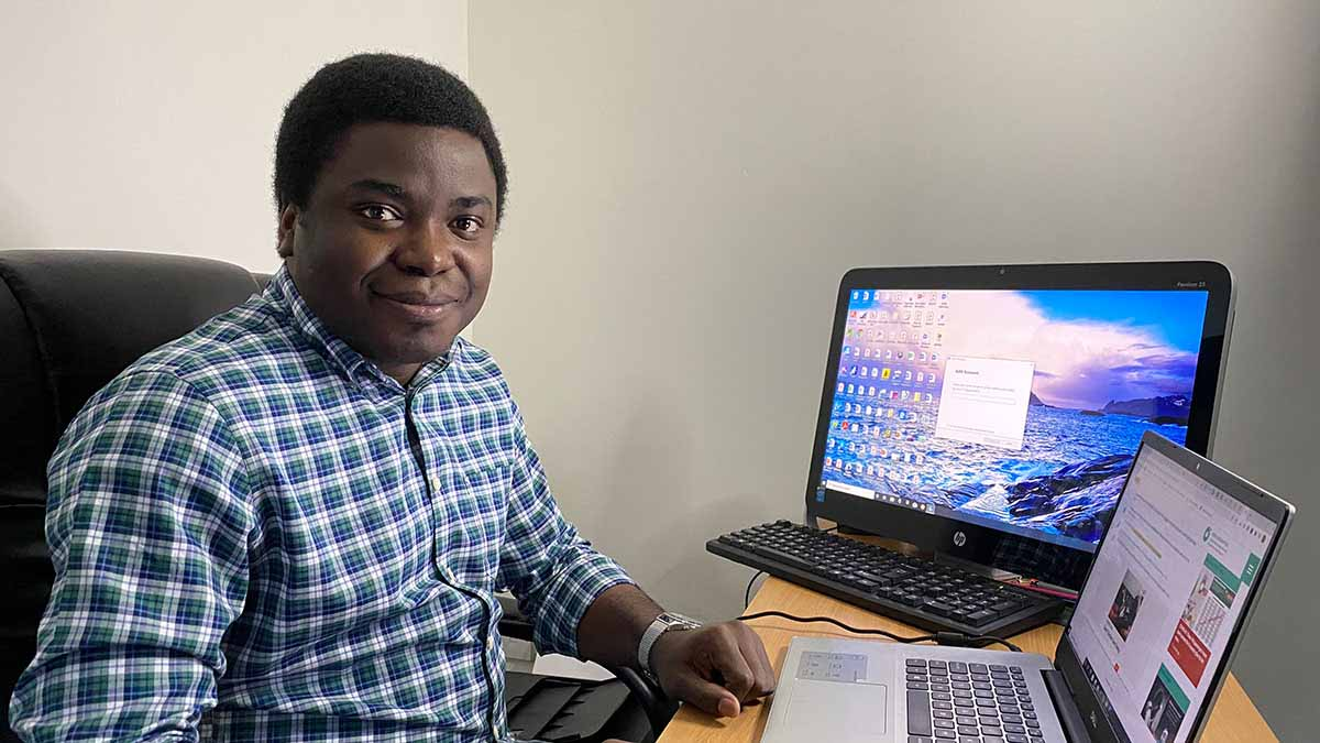 Opeyemi Ibukun at desk