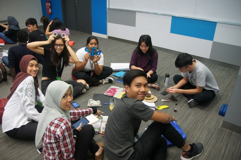 Students sitting on floor