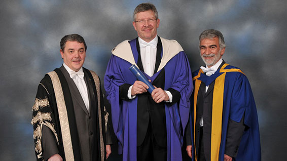 Ross Brawn poses with his honorary degree from Heriot-Watt.