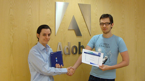 Computer Science student James Wallace (left) accepts the Adobe Edinburgh Prize for Animation, presented by James Boag of Adobe
