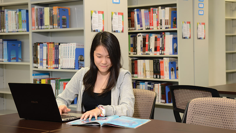 Student studying in library of Malaysia Campus