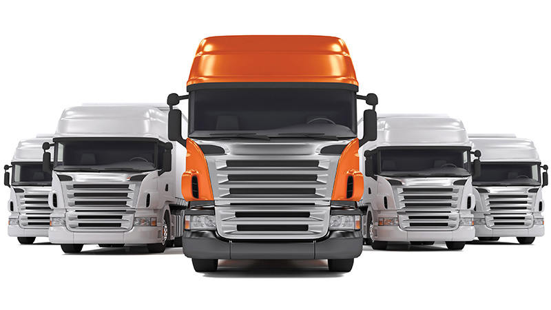 Orange truck flanked by grey trucks