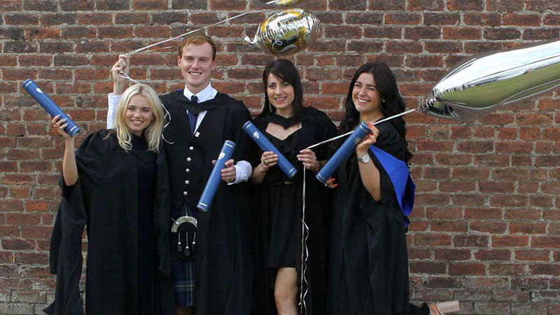 Graduates celebrate in the walled garden